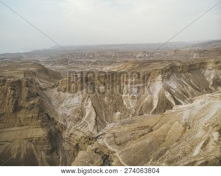 Canyon In The Judean Desert , Midbar Yehuda, On The Dead Sea, Israel. Background Of Lifeless Land In