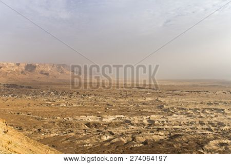 Top View From Masada Fortress To The Judaean Desert And The Dead Sea. The Desert Land Of Israel. Bac