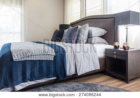 Closeup Of New Bed Comfort With Decorative Pillows Headboard In Bedroom In Staging Model Home