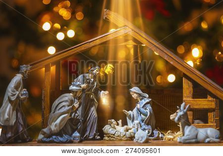 Christmas Manger Scene With Figurines Including Jesus, Mary, Joseph, Sheep And Wise Men. Focus On Ba