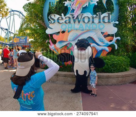 Orlando, Florida. October 26, 2018  Girl Taking Picture Of Nice Boy With Whale Character At Seaworld
