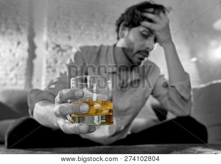Depressed Unhappy Young Man Drinking Alcoholic Drink From Glass In Alcohol Addiction And Depression