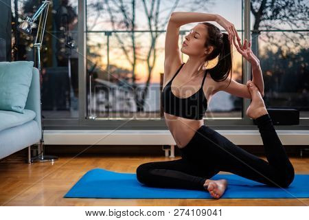 Woman practicing home yoga at home