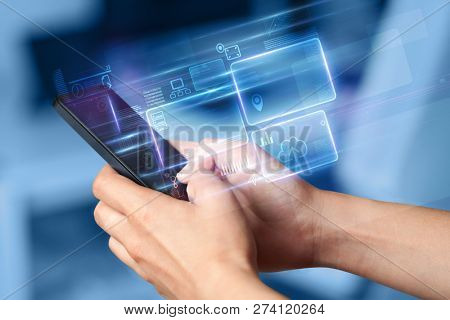 Hand using  phone with database reports and online work concept
