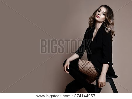Young Sensual Beautiful Sexy Woman Posing In Fashion Black Jacket Fashion On Beige Background