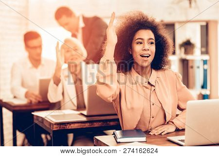 Pupils Is Studying. Female Students Is Raises A Hand. Teacher Is Talking With Male Pupil. Students I