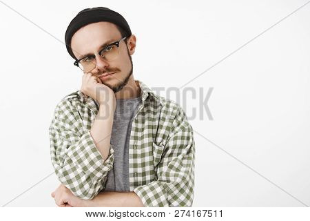 Waist-up Shot Of Indifferent Unemotive Bored Good-looking Female Student In Hipster Beanie Glasses A