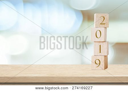 2019 Happy New Year Greeting Card, Wooden Cubes With 2019 Over Blur Bokeh Background With Copy Space