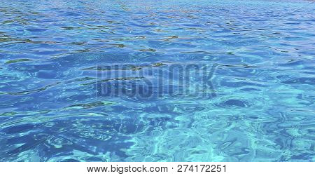 Clear Water Of Ocean. Background Of Water. Shining Blue Water. Over The Water.