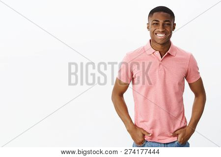 Waist-up Shot Of Attractive Positive And Happy Young African American Male Entrepreneur In Pink Polo