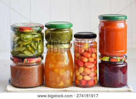 Variety Of Preserved Food In Glass Jars - Pickles, Jam, Marmalade, Sauces, Ketchup. Preserving Veget