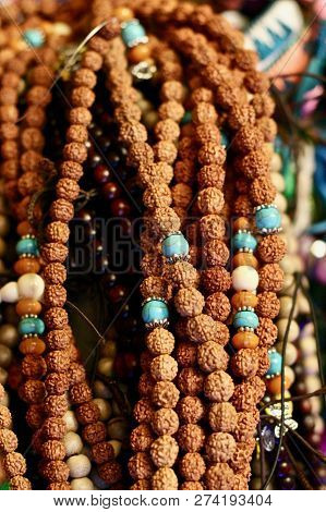 Rudraksha Seed Jewellery With Turquoise Beads As Souvenirs And Spiritual Prayer Mala Necklaces In An