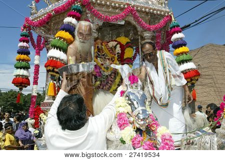NEW YORK - AUGUST 30:  Hindu men celebrate the birth of Ganesh, mythical god of new endeavors, at the Sri Ganesa Chaturthi event August 30, 2003 in Flushing, New York.