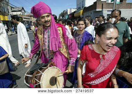 NEW YORK - AUGUST 30:  Hindus dance as they celebrate the birth of Ganesh, mythical god of new endeavors, at the Sri Ganesa Chaturthi event August 30, 2003 in the Flushing neighborhood of New York.