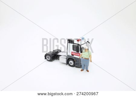 A Scale Of Police Lorry With Figure