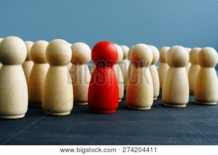 Difference, Dissimilarity And Distinctness Concept. Wooden Figures On A Desk.