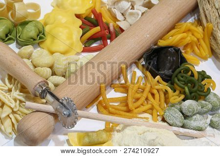 A Kitchen Rolling Pin And Fresh Italian Pasta Made With Natural Ingredients Egg Water And Flour