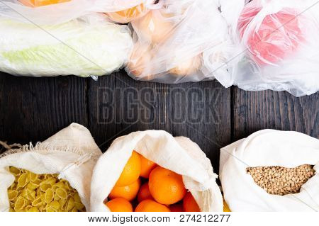 Fresh Vegetables And Fruits In Eco Cotton Bags Against Vegetables In Plastic Bags. Zero Waste Concep
