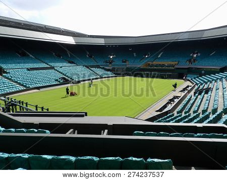 Wimbledon, United Kingdom. August 2016. Gardeners working in the Centre Court.