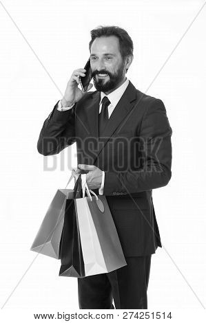 Shopping Concept. Happy Man With Shopping Bags. Shopping Addict Talk On Mobile Phone. Transforming S