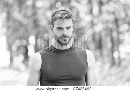 Guy Bearded Attractive Cares About Healthy Sporty Body. Man With Bristle Serious Face, Green Nature