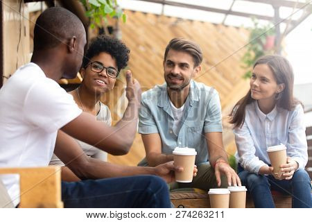 African American Man Showing Thumb Up To Friends In Cafe