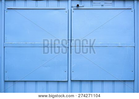 Blue Metal Shutters On A House In Germany