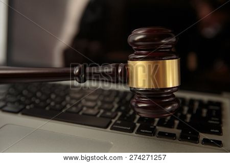 Online Auction. Auction Or Judge Gavel On A Computer Keyboard. 3d Illustration.close Up Of Wooden Br