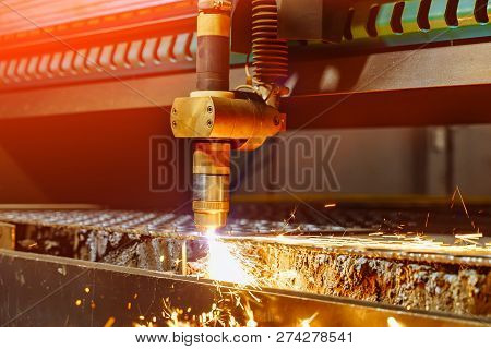 Process Of Industrial Machine Cutting Of Sheet Metal And Sparks Fly From Laser. Laser Cutting Techno