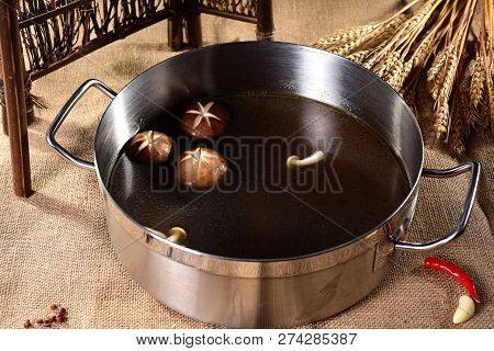 Hot Pot Of Fresh Mushroom Soup Is Placed In An Iron Pot