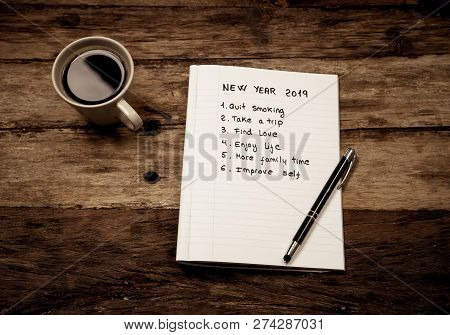 2019 New Year Written On Notebook With Coffee On Wood Table On Resolutions And Goals For Happy Life
