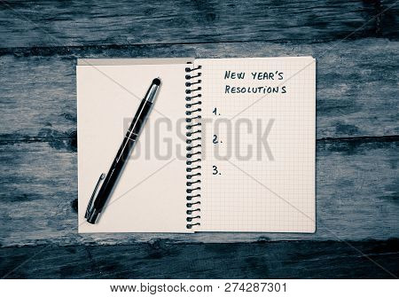 2019 New Year Resolutions Blank List Copy Space On Notebook On Wood Table In Happy Life Goals