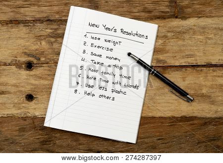 2019 New Year Resolutions List Written On Notebook On Wood Table In Plans For Better Life Goals