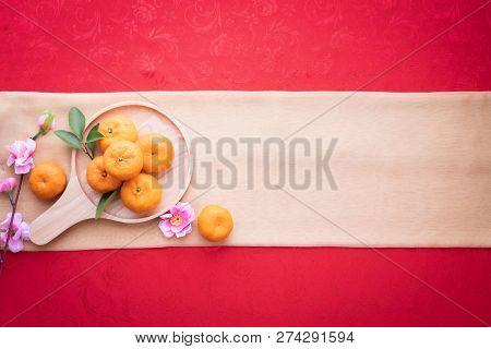 Orange Fruit, Pink Cherry Blossom With Copy Space For Text On Red Texture Background, Chinese New Ye