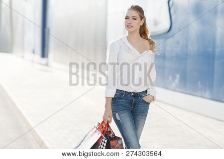 Black Friday And Boxing Day. Shopping Gift And Present On Holiday. Beautiful Women Holding A Shoppin
