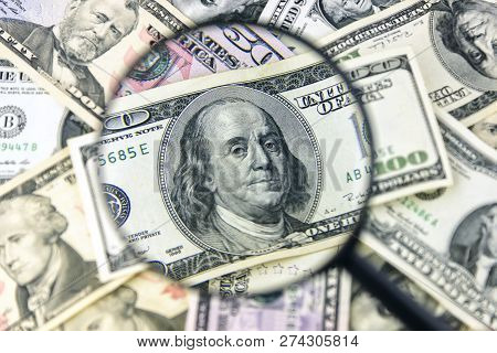 Dollar With Magnifier. Magnifying Glass And Money. Business Conc