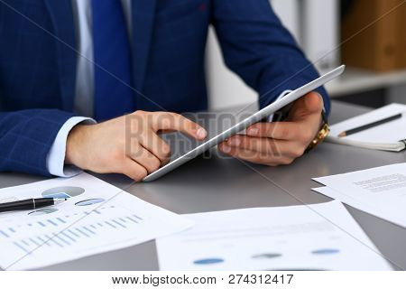 Businessman Using Touchpad At Meeting, Closeup Of Hands