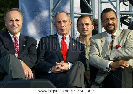 NEW YORK - JUNE 25: New York City Mayor Michael Bloomberg (C), US Sen Chuck Schumer (L) and others attend the Greater New York Billy Graham Crusade on June 25, 2005 in Flushing, NY.
