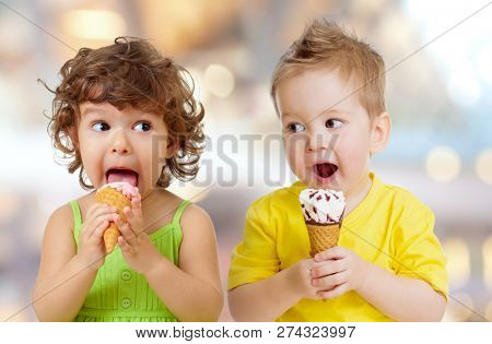 funny boy and girl eating ice cream