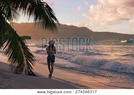 Woman On A Beach In Vacation. Young Woman In Vacation Walking On A Beach. Woman In Vacation. Woman T