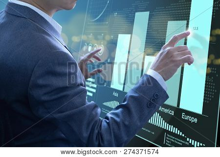 Businessman In Front Of Modern Virtual Touch Screen Analysing On Investment Risk Management And Retu