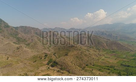 Aerial View Mountain Hilly Landscape In Asia. Mountain Range With High Cliffs Mountain Slopes Covere
