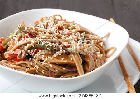 Asian Noodles Yakisoba With Beef And Oyster Mushrooms In Bowl