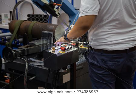 Worker Operate Band Saw Machine Cutting Metal Workpiece