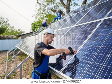 Professional Engineer Technicians Connecting Exterior Solar Photo Voltaic Panel To Metal Platform On