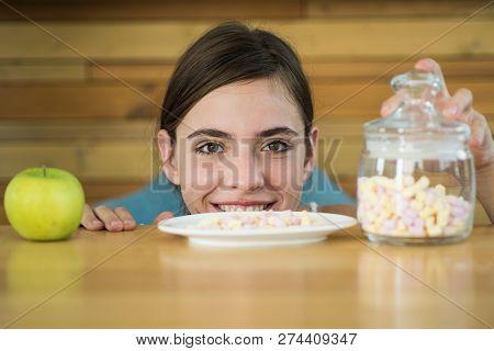 Delicious Or Harmful. Vitamin Or Sugar. Pretty Woman Look At Apple And Marshmallows. Organic And Nat