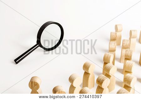 A Crowd Of People Looking Into A Magnifying Glass. Search And Tracing Concept, Find Out The Truth. F