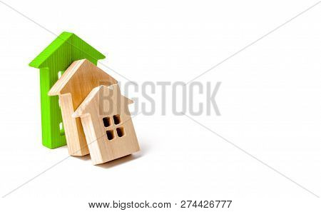 Wooden Houses Fall On Each Other Like Dominoes. The Green House Stops The Fall Of Other Houses. The