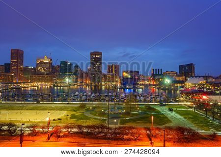 View on Baltimore skyline and Inner Harbor from Federal Hill at dusk, Maryland