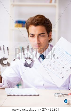 Forensic expert studying fingerprints in the lab